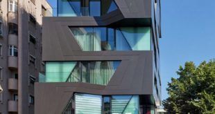 The exterior of this apartment building is a break from the construction of the cookie cutter ...