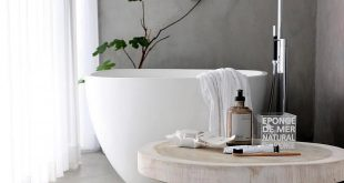 A beautiful mix of materials. Love the freestanding bath against the conc