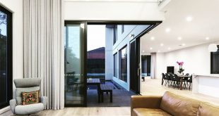 A double-height cavity in the family living room gives a sense of size