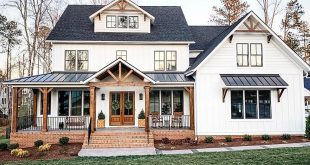 I love the metal roof over the porch! Stained elements on a black and a whit