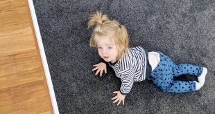 Kid loves our flooring so much that she has to crawl again ..........