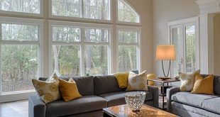 Large room of the Hickory Place Plan 5001 with a stunning, arched window wall
